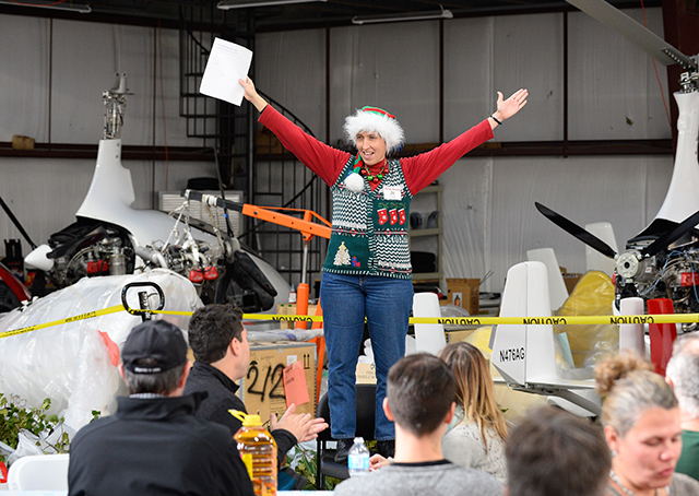 Chesapeake Sport Pilot's chief flight instructor Helen Woods welcomes pilots to the annual Tangier Island Holly Run.