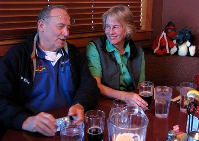 Larger than life former Congressional Flying Club President Bob Hawkins relaxes with members during an 'after-meeting' meeting. Photo courtesy of the Congressional Flying Club.