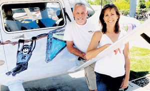 Janet Rowse and Ron Cuff of SafeLaunch with the Cessna 182. Photo courtesy of SafeLaunch.