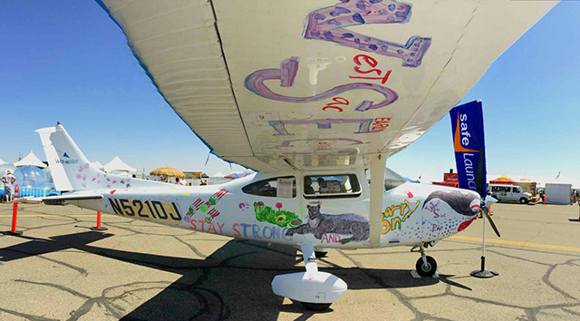 Children paint the Cessna 182 with water colors. Photo courtesy SafeLaunch.