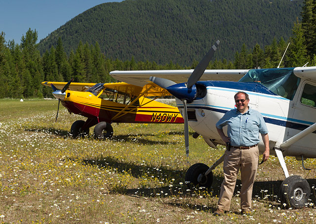John Kounis with his Cessna 185 after some backcountry flying.