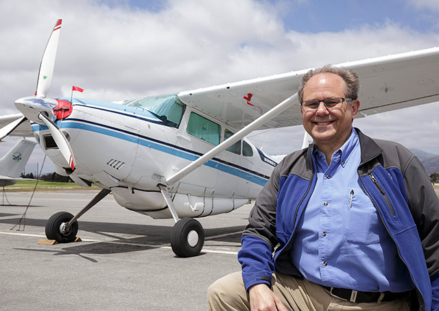 John Kounis with the Cessna 185 he ferried to Malaysia.