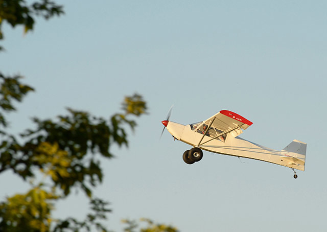 An airaft climbs near the ultralight area.
