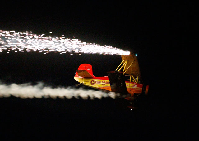 "Gene Soucy pilots his ""Showcat"" biplane in the night show at EAA AirVenture 2012."