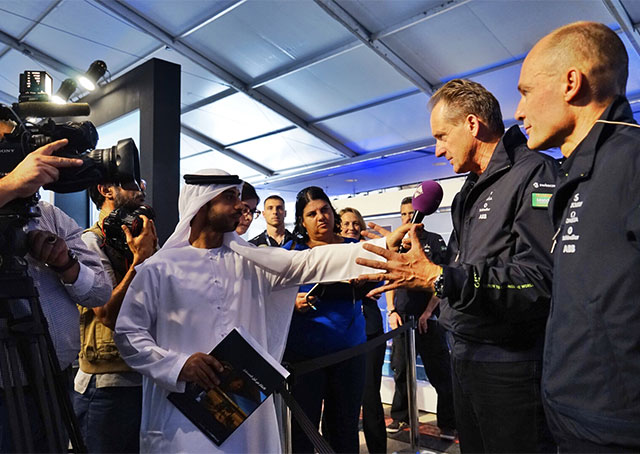 Solar Impulse pilots Bertrand Picard, far right, and André Borschberg, second from right, address the media prior to their March 9 departure. Photo courtesy of Solar Impulse.