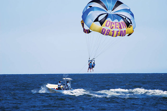 Parasailing is a popular beach sport. Photo courtesy of Town of Ocean City Tourism Office.