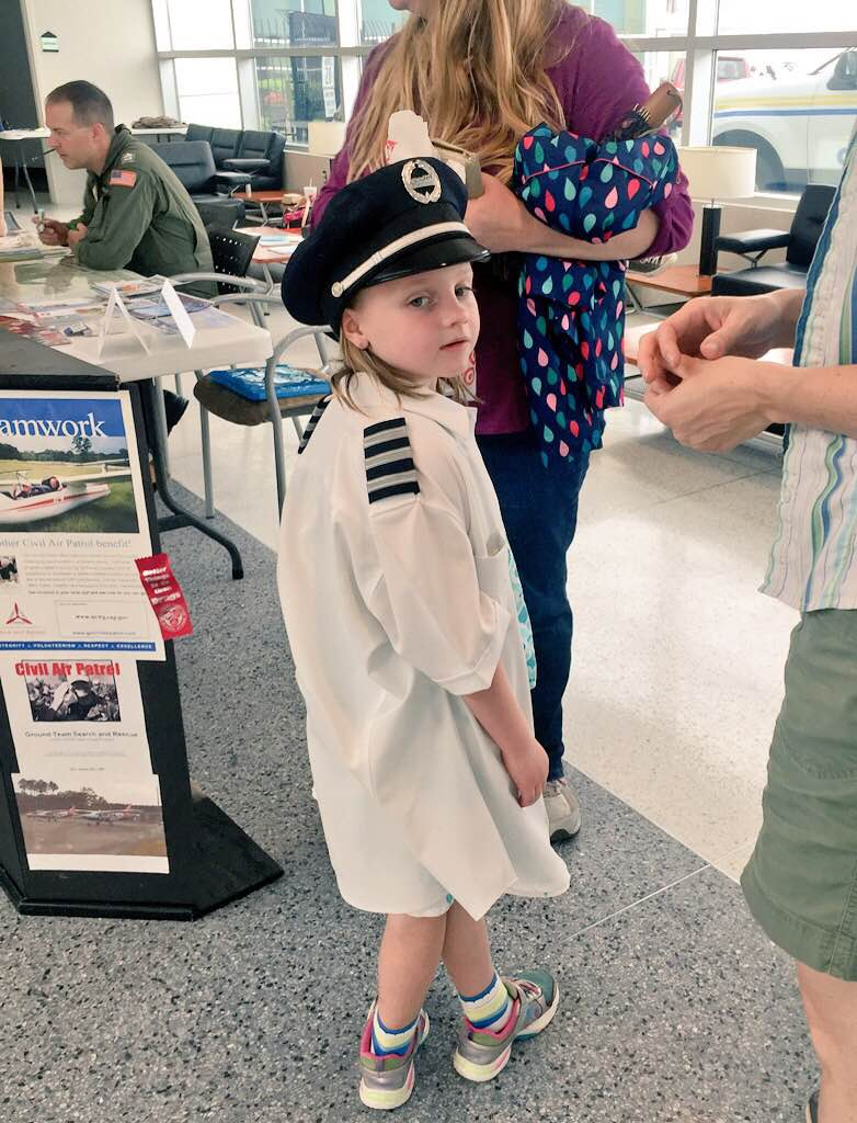 A young participant tries on pilot gear at the Girls in Aviation Day event at Raleigh-Durham International Airport in North Carolina. Photo courtesy Sarina Houston.