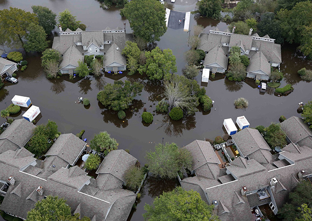 Homes in a subdivision west of the Ashley River in Charleston, South Carolina, are surrounded by floodwater Oct. 5. Photo courtesy of AP/Mic Smith.