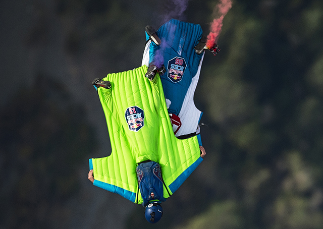 Rex Pemberton (13) of the United States and Lauren Frat (06) of France collide during the Red Bull Aces, a wingsuit four-cross race, in Cloverdale, California, Oct. 24. Joerg Mitter/Red Bull Content Pool.