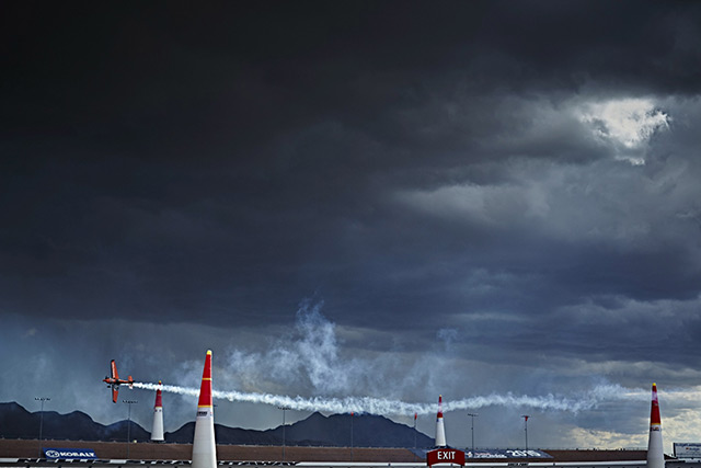 Nicolas Ivanoff of France flies under threatening skies on Oct. 18. Photo by Balazs Gardi/Red Bull Content Pool.