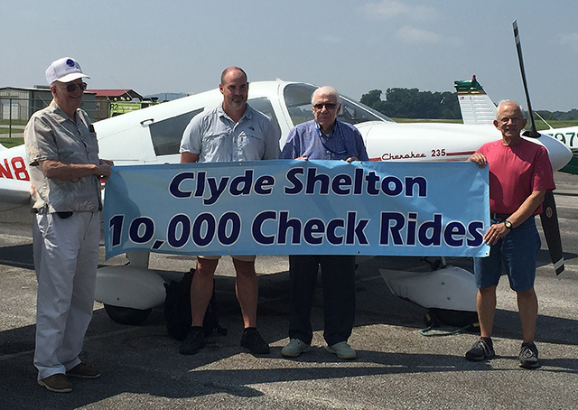 Tennessee Aviation Hall of Famer, retired NASA employee, and designated pilot examiner Clyde Shelton is recognized for awarding his ten thousandth certificate on Sept. 5, 2015, in Huntsville, Alabama. Photo courtesy of Donna Meyer.