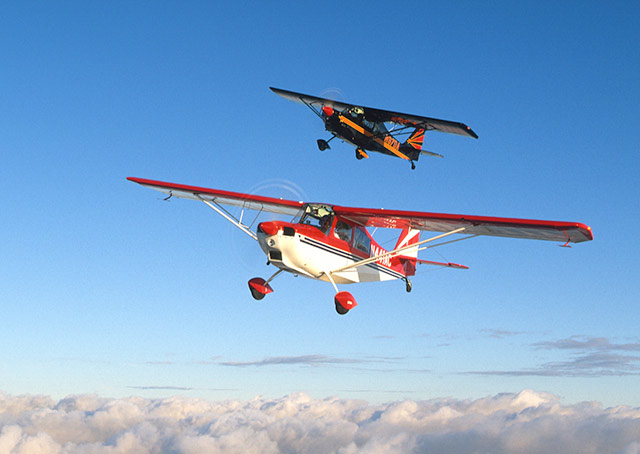 The lead airplane pictured is an American Champion 7GCAA Ultimate Adventure. AOPA file photo.