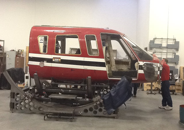 The Sikorsky S-76 fuselage was mounted to the simulator base before the restoration began.