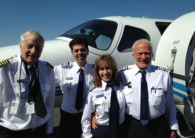 Think Global Flight Crew, left to right: Citation owners John Friedman and Edwin Sahakain; Capt Judy Rice and Dr. Buzz Aldrin
