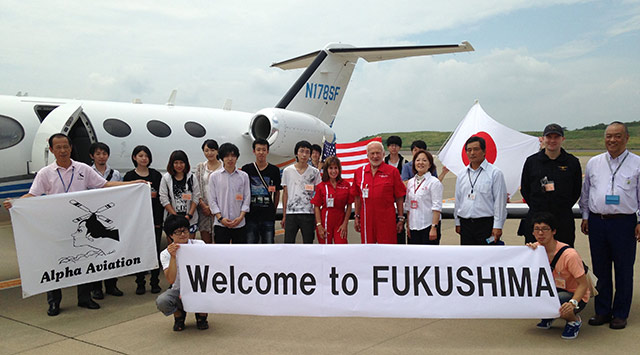 The crew is greeted in Fukushima, Japan, by participating students at Alpha Aviation.