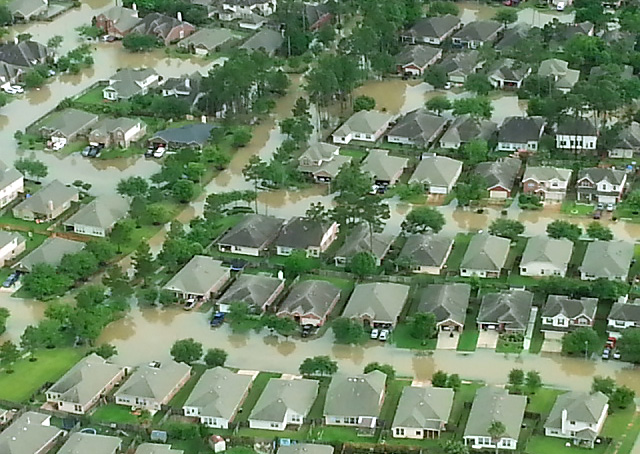 Houses are under water in vicinity of Weiser Airport near Cypress Creek and northwest of Houston. Photo by Pat Brown.