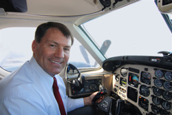 South Dakota Gov. Mike Rounds said flying for his duties as governor gives him a refreshing break from day-to-day activities: a chance to put everything else out of his mind and focus on flying. Photo courtesy of South Dakota Tourism