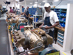 Teledyne Continental Motors Inc. employees work on the assembly line in Mobile, Ala.