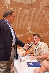 AOPA President Craig Fuller gets feedback from an attendee.